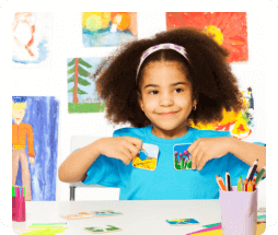 a girl showing her painting